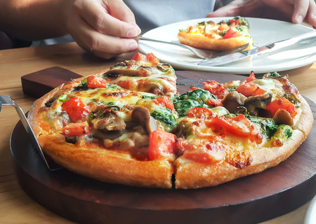 delicious vegetarian pizza on wooden table vegetarian pizza with mushroom on wooden table