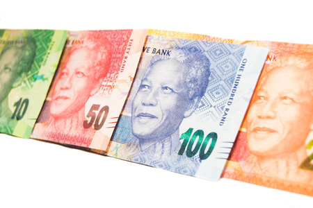 Close-up of multiple South-Africa Rand banknotes on white Stock Photo