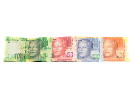 Rand banknotes from South-Africa placed in a straight line on white background