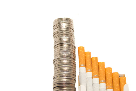 cigarette pack: Increasing cigarette prices concept with stacked coins on white background