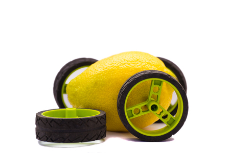 Lemon car that broke with a wheel that fell off isolated on white