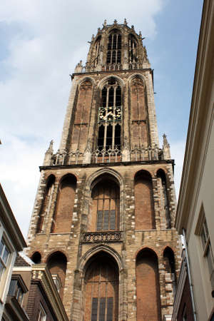 high priest: The Dom tower of 112 meters high built between 1320 and 1382 in Utrecht (Netherlands) Stock Photo