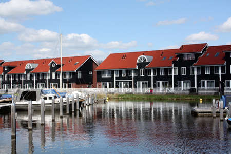 groningen: Pier houses and boats at the port Reitdiep in Groningen
