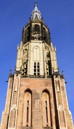 milion: Tower of the New Church (Nieuwe Kerk) from 1381 in the city of Delft. Netherlandso