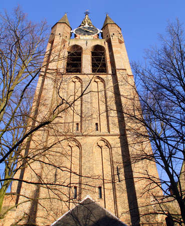 milion: Tower of the Old Church (Oude Kerk) from 1250 in the city of Delft. Netherlands Stock Photo