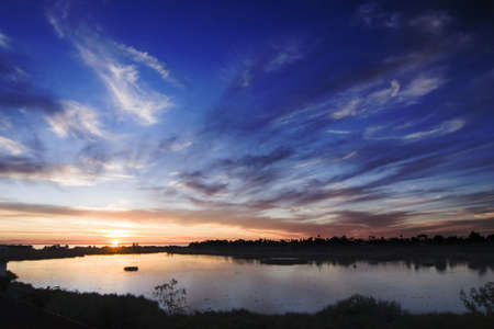 tall shot of carlsbad lagoon during sunset with oranges and blues Imagens