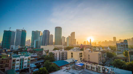 The capital of the Philippines is Manila. Makati city. Early dawn in the city.