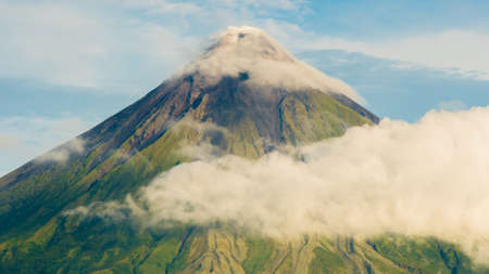 Mayon Volcano is an active stratovolcano in the province of Albay in Bicol Region, on the island of Luzon in the Philippines. Renowned as the perfect cone because of its symmetric conical shape