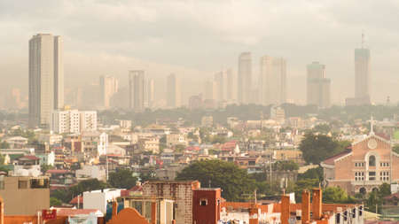 Panorama of the City of Manila with skyscrapers early in the morning.