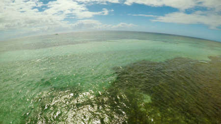 Aerial view of Bohol coast Island. Aerial. Flight is close above the water. Fisheye view. Philippines.