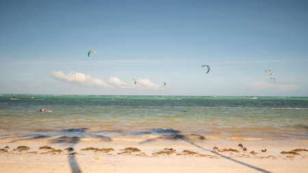 Kiteboarding. People enjoying the energy of the wind on the beach of the island of Boracay. Philippines.