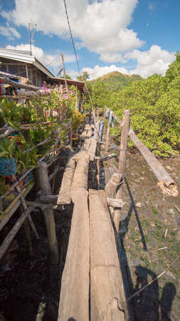 The bridge of the plaques in the poor district of Coron town. Busuanga. Views of the citys Slums from the river. Stock Photo