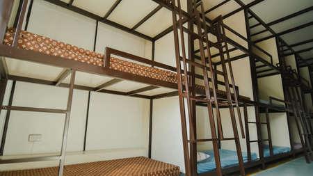 Three-story beds in a budget Asian hostel.