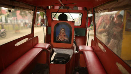 Manila, Philippines - January 5, 2018: Inside the car is a Jeepney taxi on the Philippine