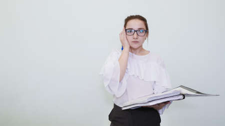 A schoolgirl in glasses depicts a successful girl with notes. A student depicts a reverie. The solution of the problem.