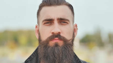 Portrait of a close-up of a brutal bearded man.