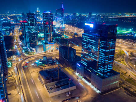Panorama of the Dubai area with a road junction and traffic at night. Stock Photo