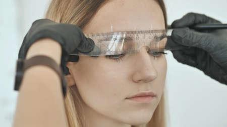 Create permanent eyebrow makeup. Markup with a ruler. Stok Fotoğraf