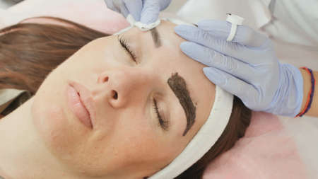 Removal of paint residues from the eyebrows. Permanent tattooing of eyebrows.