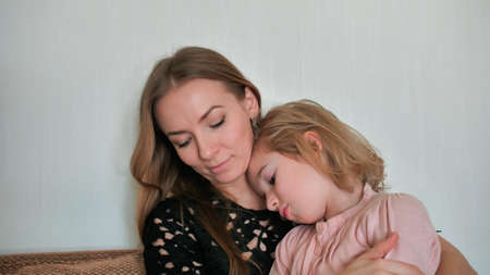 Mother calms and hugs her 6 year old daughter.
