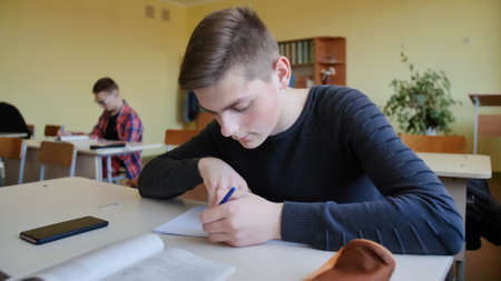 Schoolchild in class busy with work. Russian school. Stock Photo