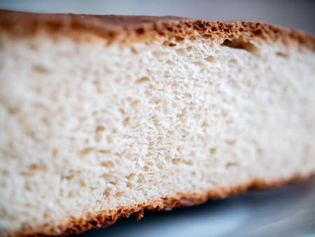 Porous white bread in the cut. Close-up.