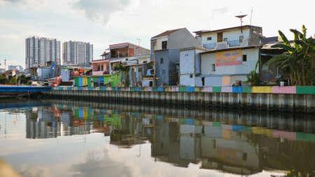 Slum area on the riverbank in Jakarta. Indonesia.