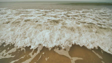 The tide of the waves of the Arabian Sea off the coast of Goa. India.