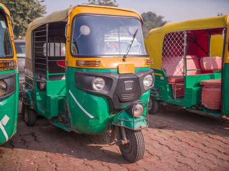 Yellow and green auto rickshaws in Indiya