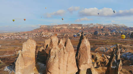 Beautiful Nature of Cappadocia on with balloons on a background of camel rocks. Turkey.