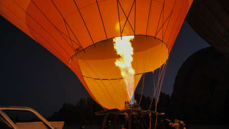Cappadocia, Turkey - January 6, 2020: Heating the balloon with fire. Turkey. Cappadocia. Editorial