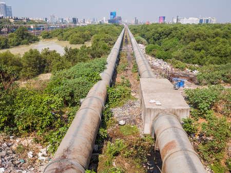 Mumbai, India - December 17, 2019: A thick pipe in a poor area of Mumbai.