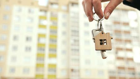 The girl holds the keys to a new apartment. The concept of buying a new apartment.