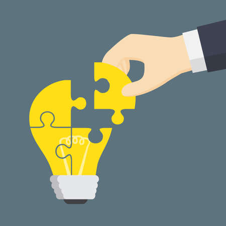 Mensen Hand Put A Part Of Light Bulb Puzzle