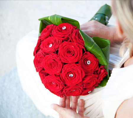 Bridal Bouquet of red roses with water droplets and crystal gems