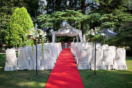 Red carpet and chairs for an outdoor wedding