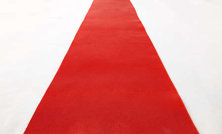 Red carpet   red ribbon on white  Stock Photo