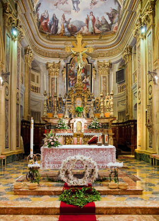 Interior of catholic church with wedding arrangements