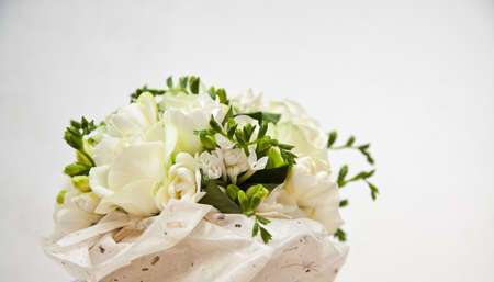 Bridal Bouquet of delicate white roses in handmade paper (with copy-space)