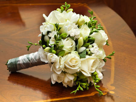 Bridal Bouquet on old and elegant table Stock Photo