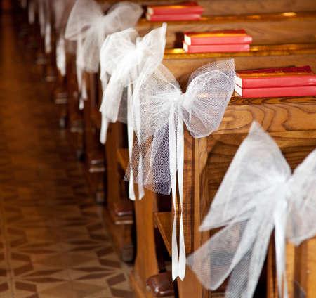 White bows in Catholic Church
