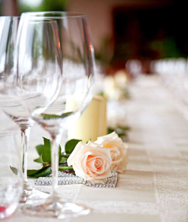 wedding table setting: Table setting at a restaurant ( two roses on a table)