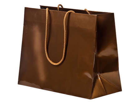 Bronze shopping bag isolated on white. photo