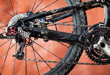 Detail of dirty mountain bike.