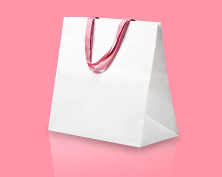 shopping sale: White shopping bag on pink.