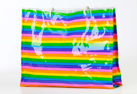 Colorful plastic bag on white photo