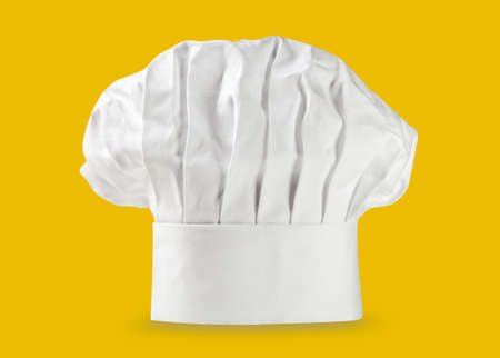 Chef hat or toque on yellow