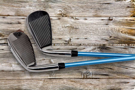 stainless steel range: Two golf clubs on wood