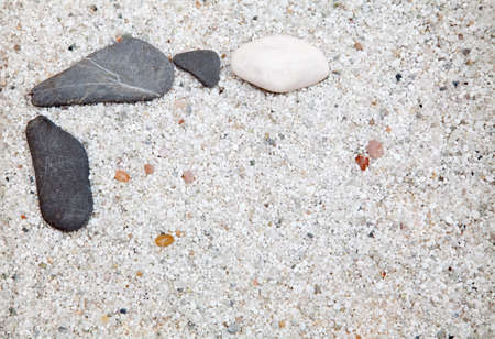 Several grey and white stone on sand photo