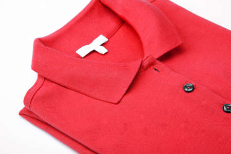 Detail of a red polo shirt. Stock Photo